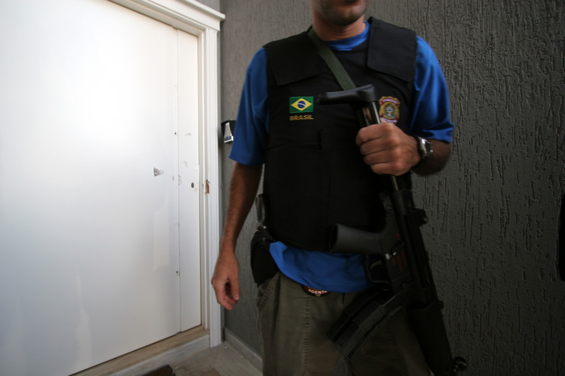 Brazilian Federal Police outside the home of Colombian drug lord Juan Carlos Ramirez Abadia in Aldeia da Serra,near Sao Paulo, Brazil. Abadia, known as Chupeta or Lollypop, suspected of ordering hundreds of murders in Colombia and the US, was detained by the Brazilian Federal Police as part of a major drugs investigation. The US state department describes him as one of the most powerful and elusive Colombian drug traffickers.(Australfoto/Douglas Engle)