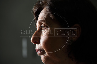 """Vitoria Grabois of the NGO Tortura Nunca Mais (Torture Never Again) at her office in Rio de Janeiro, Brazil. Grabois, who lost her father, brother and husband to the 1964-1985 Brazilian military government says the current Truth Comission proposal is not enough to officially close the dark chapter in the nation's history. Brazil is the only South American nation which has not undergone a reconciliation or judicial process of the dictatorship years. Partly because of this situation, The Inter-American Court of Human Rights ruled in 2010 the """"Brazilian government to publicly accept responsibility for grave human rights violations committed during the military regime, open its archives to the families of victims of repression, and pay millions of dollars in reparations"""" (Australfoto/Douglas Engle)"""