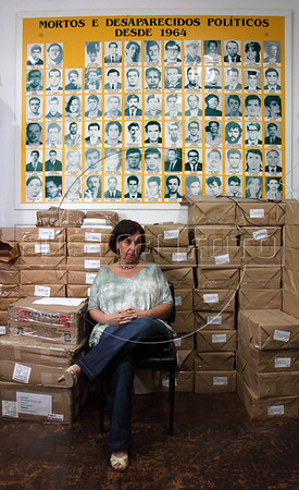 "Vitoria Grabois of the NGO Tortura Nunca Mais (Torture Never Again) near a mosaic of photos of the disappeared at her office in Rio de Janeiro, Brazil. Grabois, who lost her father, brother and husband to the 1964-1985 Brazilian military government says the current Truth Comission proposal is not enough to officially close the dark chapter in the nation's history. Brazil is the only South American nation which has not undergone a reconciliation or judicial process of the dictatorship years. Partly because of this situation, The Inter-American Court of Human Rights ruled in 2010 the ""Brazilian government to publicly accept responsibility for grave human rights violations committed during the military regime, open its archives to the families of victims of repression, and pay millions of dollars in reparations"" (Australfoto/Douglas Engle)"