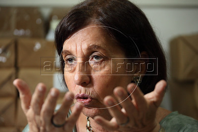 "Vitoria Grabois of the NGO Tortura Nunca Mais (Torture Never Again) at her office in Rio de Janeiro, Brazil. Grabois, who lost her father, brother and husband to the 1964-1985 Brazilian military government says the current Truth Comission proposal is not enough to officially close the dark chapter in the nation's history. Brazil is the only South American nation which has not undergone a reconciliation or judicial process of the dictatorship years. Partly because of this situation, The Inter-American Court of Human Rights ruled in 2010 the ""Brazilian government to publicly accept responsibility for grave human rights violations committed during the military regime, open its archives to the families of victims of repression, and pay millions of dollars in reparations"" (Australfoto/Douglas Engle)"