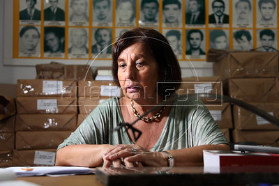 """Vitoria Grabois of the NGO Tortura Nunca Mais (Torture Never Again) behind a statue designed by Oscar Niemeyer called """"Arch of Evil"""" at her office in Rio de Janeiro, Brazil. Grabois, who lost her father, brother and husband to the 1964-1985 Brazilian military government says the current Truth Comission proposal is not enough to officially close the dark chapter in the nation's history. Brazil is the only South American nation which has not undergone a reconciliation or judicial process of the dictatorship years. Partly because of this situation, The Inter-American Court of Human Rights ruled in 2010 the """"Brazilian government to publicly accept responsibility for grave human rights violations committed during the military regime, open its archives to the families of victims of repression, and pay millions of dollars in reparations"""" (Australfoto/Douglas Engle)"""
