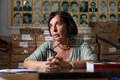 "Vitoria Grabois of the NGO Tortura Nunca Mais (Torture Never Again) behind a statue designed by Oscar Niemeyer called ""Arch of Evil"" at her office in Rio de Janeiro, Brazil. Grabois, who lost her father, brother and husband to the 1964-1985 Brazilian military government says the current Truth Comission proposal is not enough to officially close the dark chapter in the nation's history. Brazil is the only South American nation which has not undergone a reconciliation or judicial process of the dictatorship years. Partly because of this situation, The Inter-American Court of Human Rights ruled in 2010 the ""Brazilian government to publicly accept responsibility for grave human rights violations committed during the military regime, open its archives to the families of victims of repression, and pay millions of dollars in reparations"" (Australfoto/Douglas Engle)"