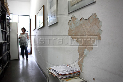 "Vitoria Grabois of the NGO Tortura Nunca Mais (Torture Never Again), next to peeling paint which remarkably resembles the shape of Brazil, at her office in Rio de Janeiro, Brazil. Grabois, who lost her father, brother and husband to the 1964-1985 Brazilian military government says the current Truth Comission proposal is not enough to officially close the dark chapter in the nation's history. Brazil is the only South American nation which has not undergone a reconciliation or judicial process of the dictatorship years. Partly because of this situation, The Inter-American Court of Human Rights ruled in 2010 the ""Brazilian government to publicly accept responsibility for grave human rights violations committed during the military regime, open its archives to the families of victims of repression, and pay millions of dollars in reparations"" (Australfoto/Douglas Engle)"