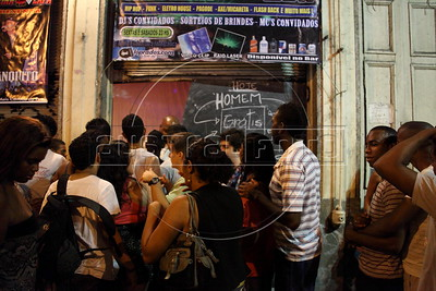 Clients wait to enter a club in  Rio de Janeiro where American Alex Cutler, better known as Don Blanquito, has a performance. After a stint on Wall Street, Blanquito has now emerged as a prominent singer of Carioca funk -- the music of Rio's slums. With a privileged upbringing in L.A., and even has several degrees including an MBA, Cutler  adopted a stage name and threw it all away to chase his dream as a funk performer. His story reflects the shifting dynamics of Rio's favelas, which are home to a growing number of adventurous foreigners, and the evolution of funk music, which some critics say is dying a slow death as life in the favelas gradually improves.(Douglas Engle/Australfoto)