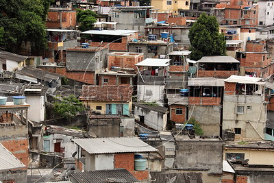 A view of the Rio de Janeiro favela. or slum, where Alex Cutle, better known as Don Blanquito, lives. After a stint on Wall Street, Blanquito has now emerged as a prominent singer of Carioca funk -- the music of Rio's slums. With a privileged upbringing in L.A., and even has several degrees including an MBA, Cutler  adopted a stage name and threw it all away to chase his dream as a funk performer. His story reflects the shifting dynamics of Rio's favelas, which are home to a growing number of adventurous foreigners, and the evolution of funk music, which some critics say is dying a slow death as life in the favelas gradually improves.(Douglas Engle/Australfoto)