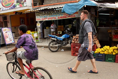 American Alex Cutler, better known as Don Blanquito walks through one of the working-class suburbs of Rio de Janeiro. After a stint on Wall Street, Blanquito has now emerged as a prominent singer of Carioca funk -- the music of Rio's slums. With a privileged upbringing in L.A., and even has several degrees including an MBA, Cutler  adopted a stage name and threw it all away to chase his dream as a funk performer. His story reflects the shifting dynamics of Rio's favelas, which are home to a growing number of adventurous foreigners, and the evolution of funk music, which some critics say is dying a slow death as life in the favelas gradually improves.(Douglas Engle/Australfoto)