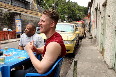 American Alex Cutler, better known as Don Blanquito, in the Rio de Janeiro favela. or slum, where he lives. After a stint on Wall Street, Blanquito has now emerged as a prominent singer of Carioca funk -- the music of Rio's slums. With a privileged upbringing in L.A., and even has several degrees including an MBA, Cutler  adopted a stage name and threw it all away to chase his dream as a funk performer. His story reflects the shifting dynamics of Rio's favelas, which are home to a growing number of adventurous foreigners, and the evolution of funk music, which some critics say is dying a slow death as life in the favelas gradually improves.(Douglas Engle/Australfoto)