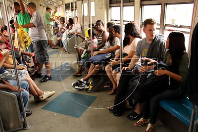 American Alex Cutler, better known as Don Blanquito, rides in a commuter train in Rio de Janeiro to a suburb with his girlfriend Yasmin Leiros. After a stint on Wall Street, Blanquito has now emerged as a prominent singer of Carioca funk -- the music of Rio's slums. With a privileged upbringing in L.A., and even has several degrees including an MBA, Cutler  adopted a stage name and threw it all away to chase his dream as a funk performer. His story reflects the shifting dynamics of Rio's favelas, which are home to a growing number of adventurous foreigners, and the evolution of funk music, which some critics say is dying a slow death as life in the favelas gradually improves.(Douglas Engle/Australfoto)