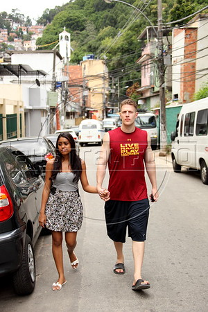 American Alex Cutler, better known as Don Blanquito, with his girlfriend Yasmin Leiros in the Rio de Janeiro favela. or slum, where he lives. After a stint on Wall Street, Blanquito has now emerged as a prominent singer of Carioca funk -- the music of Rio's slums. With a privileged upbringing in L.A., and even has several degrees including an MBA, Cutler  adopted a stage name and threw it all away to chase his dream as a funk performer. His story reflects the shifting dynamics of Rio's favelas, which are home to a growing number of adventurous foreigners, and the evolution of funk music, which some critics say is dying a slow death as life in the favelas gradually improves.(Douglas Engle/Australfoto)