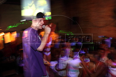 American Alex Cutler, better known as Don Blanquito, performs in a club in Rio de Janeiro. After a stint on Wall Street, Blanquito has now emerged as a prominent singer of Carioca funk -- the music of Rio's slums. With a privileged upbringing in L.A., and even has several degrees including an MBA, Cutler  adopted a stage name and threw it all away to chase his dream as a funk performer. His story reflects the shifting dynamics of Rio's favelas, which are home to a growing number of adventurous foreigners, and the evolution of funk music, which some critics say is dying a slow death as life in the favelas gradually improves.(Douglas Engle/Australfoto)