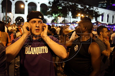American Alex Cutler, better known as Don Blanquito, outside a club in  Rio de Janeiro before a performance there. After a stint on Wall Street, Blanquito has now emerged as a prominent singer of Carioca funk -- the music of Rio's slums. With a privileged upbringing in L.A., and even has several degrees including an MBA, Cutler  adopted a stage name and threw it all away to chase his dream as a funk performer. His story reflects the shifting dynamics of Rio's favelas, which are home to a growing number of adventurous foreigners, and the evolution of funk music, which some critics say is dying a slow death as life in the favelas gradually improves.(Douglas Engle/Australfoto)
