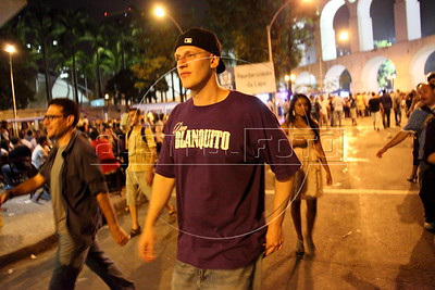 American Alex Cutler, better known as Don Blanquito greets fans after a performance as he walks through the bohemian Lapa district of central Rio de Janeiro. After a stint on Wall Street, Blanquito has now emerged as a prominent singer of Carioca funk -- the music of Rio's slums. With a privileged upbringing in L.A., and even has several degrees including an MBA, Cutler  adopted a stage name and threw it all away to chase his dream as a funk performer. His story reflects the shifting dynamics of Rio's favelas, which are home to a growing number of adventurous foreigners, and the evolution of funk music, which some critics say is dying a slow death as life in the favelas gradually improves.(Douglas Engle/Australfoto)