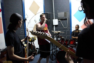 Alex Cutler, better known as Don Blanquito, practices with a Brazilian rock band in a move to try new sounds in Rio de Janeiro. Don Blanquito lives in one of Rio de Janeiro's favelas and has emerged as a prominent singer of Carioca funk -- the music of Rio's slums. He had a privileged upbringing in L.A., and even has several degrees including an MBA, then adopted a stage name and threw it all away to chase his dream as a funk performer. His story reflects the shifting dynamics of Rio's favelas, which are home to a growing number of adventurous foreigners, and the evolution of funk music, which some critics say is dying a slow death as life in the favelas gradually improves.(Douglas Engle/Australfoto)
