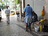 """A man check results at a stand of the """"Animal Game,"""" right, in Rio de Janeiro, May 28, 2007. The Animal Game (Jogo do Bicho) is an illegal lottery game played all over Brazil, but mostly in Rio de Janeiro. Started by a businessman to promote a zoo in the 1800s, customers can bet any amount on numbers which correspond to 25 animals. There are three daily drawings, and winners can collect their earnings at the spot they made the bet, which is usually a person sitting at a corner or local bar with a desk and notepad. Despite its widespread popularity, it is still illegal and those involved may be prosecuted. (Australfoto/Douglas Engle)"""