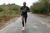 Runner Ronaldo da Costa trains on a rural highway near Sao Joao Nepomucemo in Brazil's southeastern state of Minas Gerais. The youngest of 11 children, and from a simple country home,  Da Costa came from nowhere to break the 10 year old marathon world record in Berlin in 1998 with a time of 2:06:05., and has since returned to relative obscurity. Da Costa cherishes his moment of glory but does not dwell on his lackluster performances since 1998. He has invested in real estate in his town and is busy starting an athletic association for young people. (Australfoto/Douglas Engle)