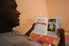 Runner Ronaldo da Costa looks at a magazine story about himself from his archive in his home in Sao Joao Nepomucemo in Brazil's southeastern state of Minas Gerais. The youngest of 11 children, and from a simple country home,  Da Costa came from nowhere to break the 10 year old marathon world record in Berlin in 1998 with a time of 2:06:05., and has since returned to relative obscurity. Da Costa cherishes his moment of glory but does not dwell on his lackluster performances since 1998. He has invested in real estate in his town and is busy starting an athletic association for young people. (Australfoto/Douglas Engle)