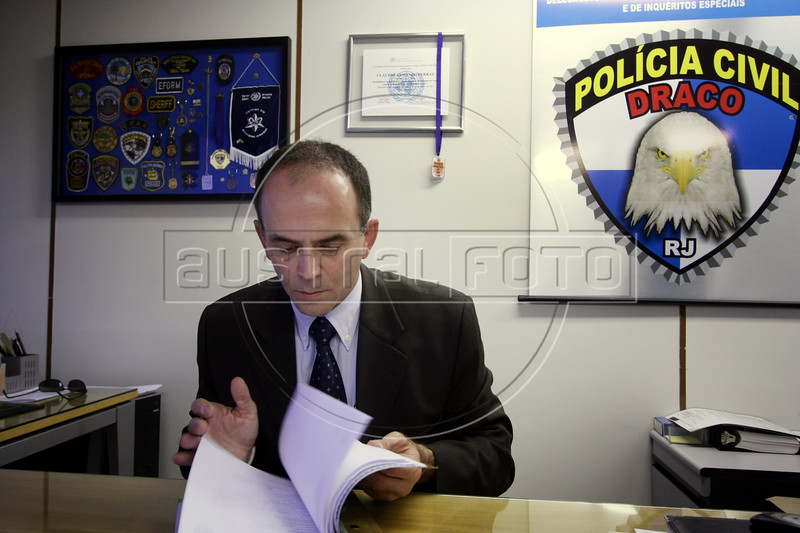 "Claudio Ferraz, Chief of Rio Police's Organized Crime Unit (DRACO)  in his office in Rio de Janeiro, June 6, 2008. Ferraz is investigating the torture of undercover journalists by a paramilitary group, known as ""militias,"" in a Rio slum in May. Militias have taken over some slums from drug traffickers, rule with an iron hand, and charge a ""toll"" for many basic services from cooking gas, cable TV and transport. Ferraz compared the situation to the film ""Gangs of New York."" (Australfoto/Douglas Engle)"