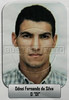 """Police handout photo of """"militia"""" leader Odnei Fernando da SIlva, detained after torturing undercover journalists in a Rio de Janeiro slum. The militia, now gone from the slum, tortured a group of undercover journalists when they discovered their identity.  Militias have taken over some slums from drug traffickers, rule with an iron hand, and charge a """"toll"""" for many basic services from cooking gas, cable TV and transport. While many residents do not agree with some of their methods, they say are better off with them than the traffickers. Now that the militias have left, slum residents fear an eventual battle for the """"vacant"""" turf.(Australfoto/Douglas Engle)"""