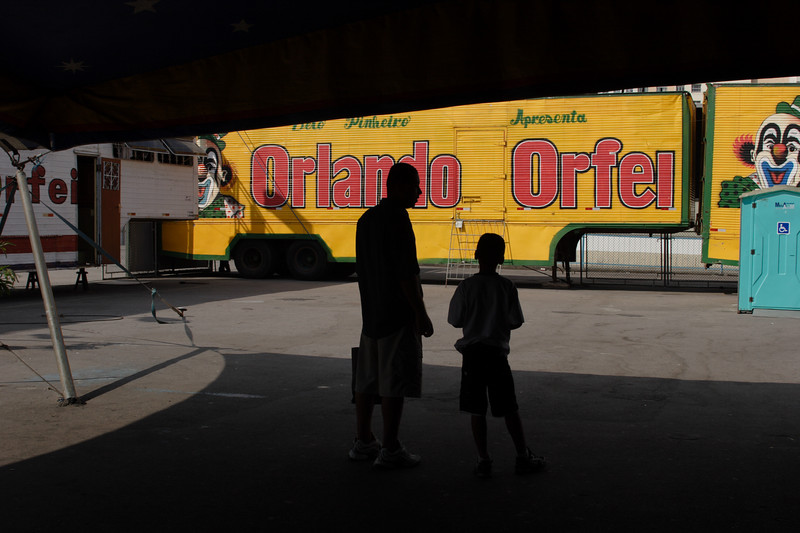 A man and boy wait to enter the Orlando Orfei circus in Rio de Janeiro, Brazil. An Italian national, Orlando Orfei emigrated to Brazil in 1968 and leads one of the most traditional circuses of the world; the Orfei name is practically synonymous with circus, as his father, grandfather, uncles and cousins have all used Orfei name. Orlando himself has been in the circus business since the age of five. He has been a clown, magician, acrobat and beast tamer.(Australfoto/Douglas Engle)