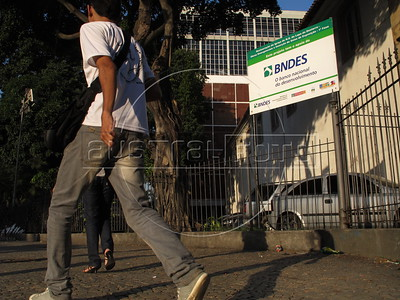 Signs announcing financing by the Brazilian Development Bank (BNDES) outside buildings in Rio de Janeiro, Brazil. (Australfoto/Douglas Engle)