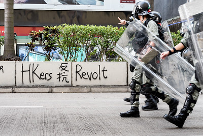 Riot police march down Nathan Road, Hong Kong. October 27, 2019.