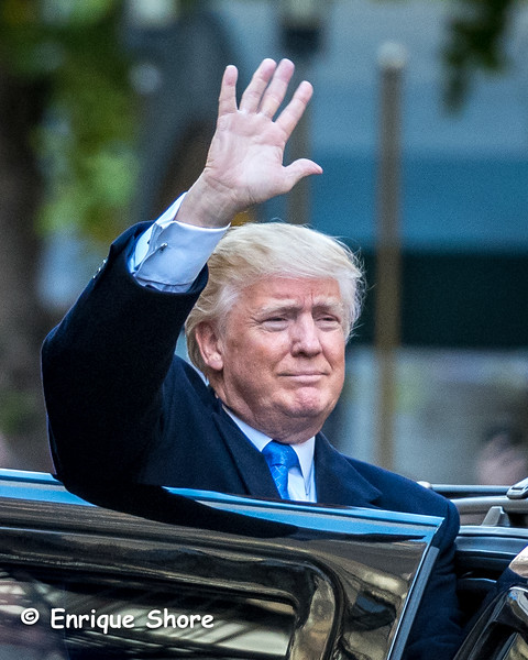 Trump waves after casting his vote in the US presidential elections