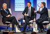 Bill Clinton, Italian PM Renzi and Argentine President Macri laugh on stage during Clinton Global Initiatiive meeting