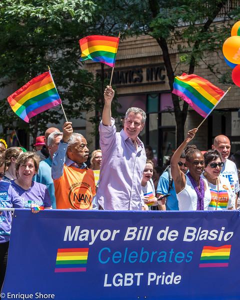 New York City Mayor de Blasio, wife McCray and Al Sharpton march during Pride parade