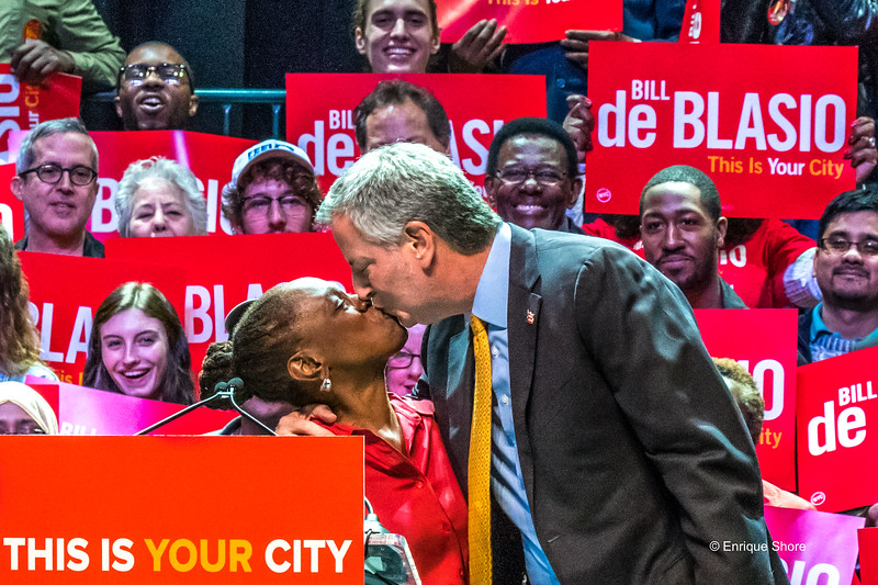 New York Mayor De Blasio and wife kiss at a campaign rally
