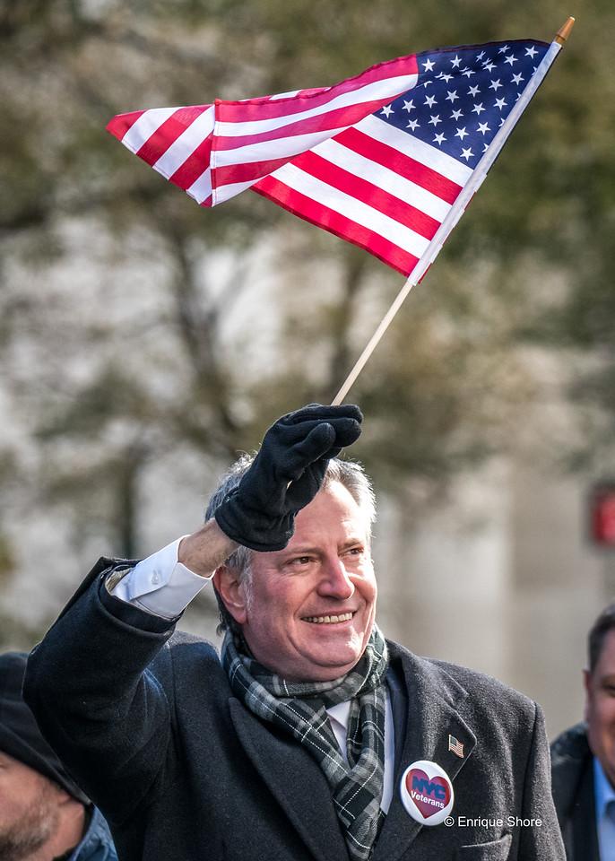 Mayor De Blasio waves flag at Veterans Day Parade 2017 in New York City