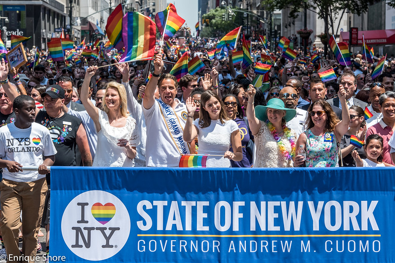 New York State Governor Cuomo parades with his daughter and companion in 2016 Pride march