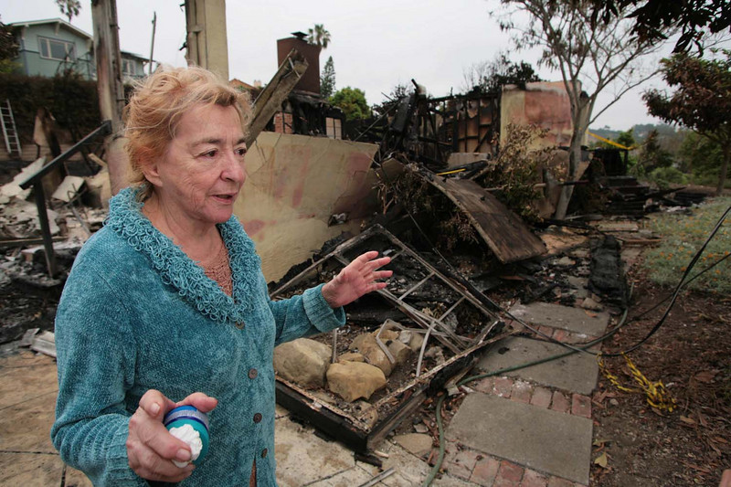 Forced to evacuate during the Jesusita wildfire, Faye Pratini, 79, returned to find her Santa Barbara, Calif., home completely destroyed on Sunday, May 10, 2009.  She has lived there with her husband since 1979.  High winds sent flame and embers from an adjacent home into hers, while leaving neighbors' homes unscathed.  (AP Photo by Eric Parsons)