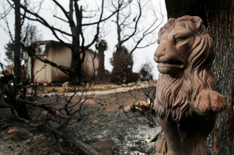 A stone figurine is almost all that was left standing at a home along Holly Road on Sunday, May 10, 2009, in the wake of the Jesusita fire that engulfed more than 8,000 acres and destroyed over 80 houses.  The Mission Canyon area was hit particularly hard, seeing the destruction of several grand, luxurious homes.  (AP Photo by Eric Parsons)