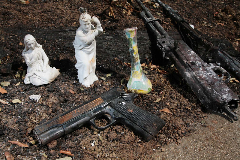 One of the more unusual discoveries that firemen made in the aftermath of the Jesusita fire in Santa Barbara, Calif., was an odd collection of firearms and ceramic figurines at a burned home along Palomino Road on Sunday, May 10, 2009.  The Jesusita fire forced the evacuation of thousands of residents and burned some 80 homes.  (AP Photo by Eric Parsons)