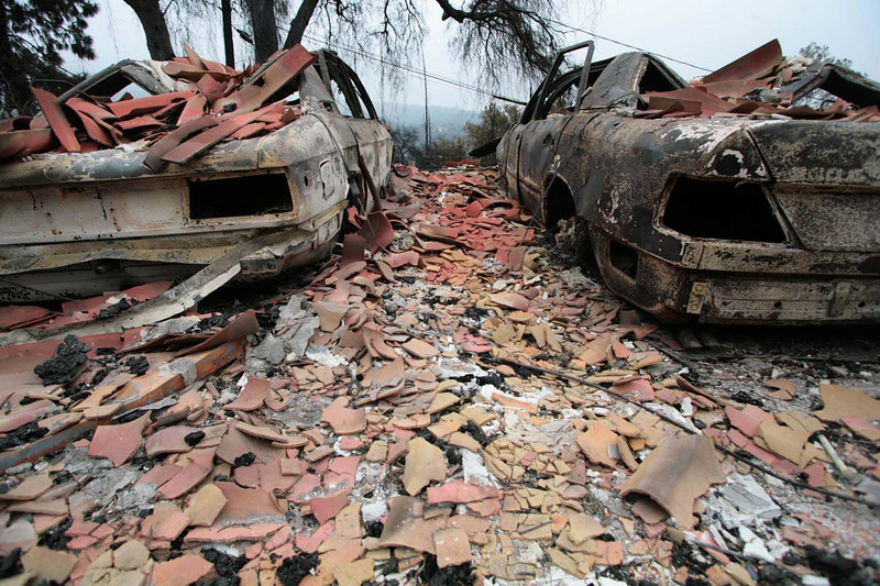The charred hulls of two Mercedes cars are evindence of the ferocity of the Jesusita fire on Sunday, May 10, 2009, where flames ravaged this home along Holly Road in the Mission Canyon area of Santa Barbara, Calif.  In all, more than 80 homes and over 8,000 acres were burned in the wind-driven wildfire.   (AP Photo by Eric Parsons)