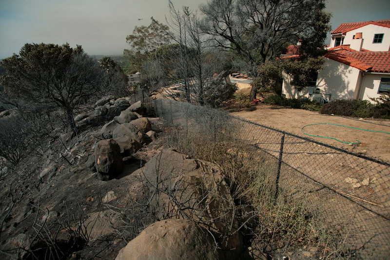 This home in Santa Barbara, Calif., on a ridge overlooking San Marcos Pass Road emerged unscathed on Friday, May 8, 2009, after the Jesusita wildfire jumped its western flank overnight and threatened more neighborhoods.  (AP Photo by Eric Parsons)