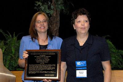 President Linda Poston honors retiring Executive Director Nancy Olson