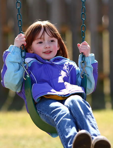 Megan on her swing at Fox Park in early 2009.