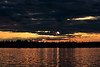 Sunset, combined with a coming storm.  Shot in Canada on Bruce lake in May 2008.