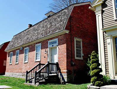 A brick schoolhouse that was constructed in 1783 and named for Dr. Daniel Lathrop who bequeathed 500 pounds for the endowment of a free grammar school. One of the oldest brick schoolhouses still standing in the State of Connecticut.