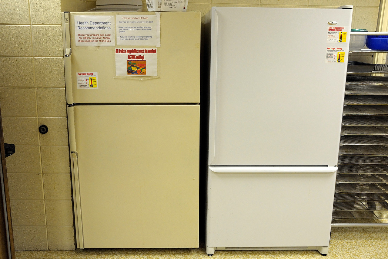 Two refrigerators.  The yellow one to the left is to be used for old food - 7 days or less, and the white one to the right is for new unused food.