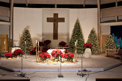 Church decorated for Christmas and microphones set to go.