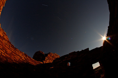 T3i with 8mm fisheye. The moon crept into the frame at the very end of the 30 minute exposure.  neato!