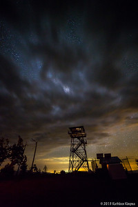 Clouds were coming and going all night long...  not great for star gazing, but they sure made this a dramatic photo!