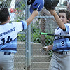 ROBERT GURECKI   -   DFM<br /> Aston Middletown's Roman Tozzi, right, bumps helmuts with teammate Nikko Partsanarkis, right, as he touches home plate for the score in District 19 Little League play.