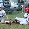 ROBERT GURECKI   -   Digital First Media<br /> Taney Little League player Diego Spiel-Rad, right, slides into third safely after the ball gets away from Aston Mkddletown's third baeman Quinten Perilli duirng  the District 19 playoff game at Aston Middletown.
