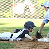 ROBERT GURECKI   -   DFM<br /> Aston Middletown's Brendan Duffy, right, tries to pick off Taney's Gabe Olson at second base during District 19 Little League play at Aston Middletown's field, Aston.