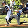 ROBERT GURECKI   -   Digital First Media<br /> Taney third baseman Oscar Rathmann, left, grabs the ground ball and races Aston Midletown's Roman Tozzi, right, to third base for the out.