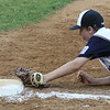 ROBERT GURECKI   -   Digital First Media<br /> Taney Little League first baseman Sage Taylor fields a gound ball and stretches  to reach first base to tag out Aston Middletown's runner during the 2nd round of the Little League playoffs held at Aston Middletown's field.