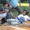 ROBERT GURECKI   -   Digital First Media<br /> Aston Middletown's Quinten Perilli slides under the tag of Taney catcher Riley Kravitz for a score during the Little League playoff held at Aston Middletown's field, Aston.